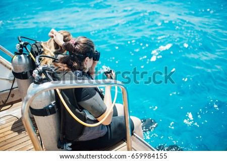 Scuba diver before diving. Diving lesson in open water. #659984155