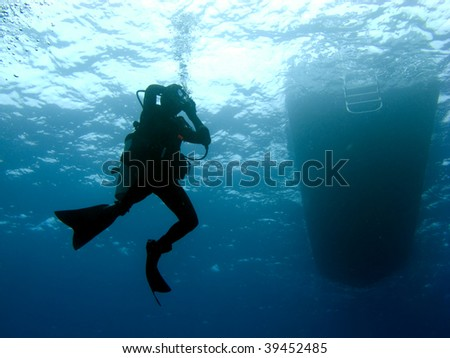 Scuba Diver Clearing Mask while Descending under the Boat #39452485