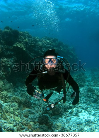 Scuba Diver looking into the Camera in Kona Hawaii