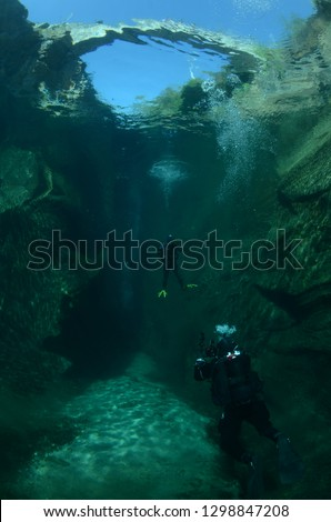 Scuba diver near a Roman bridge #1298847208
