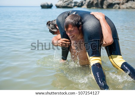 Scuba diver rescuing a diver from the sea