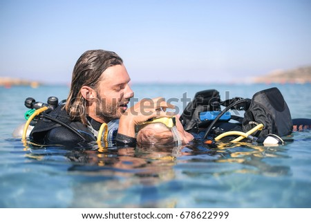Scuba diver rescuing a girl who doesn't feel good #678622999