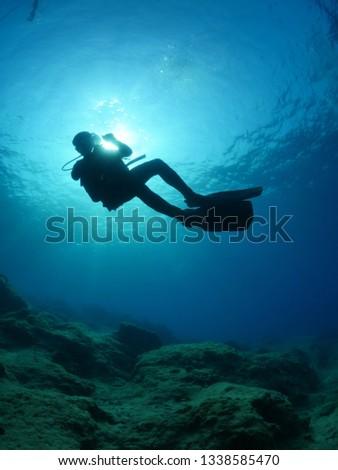 scuba diver silhouette underwater sun beam sun ray sun shine #1338585470