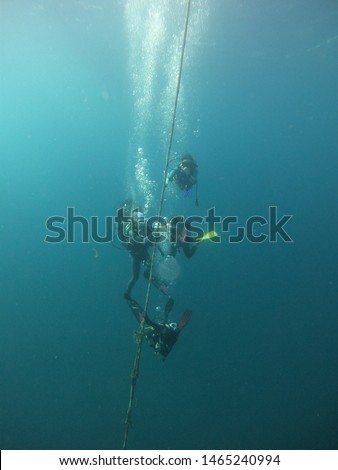 Scuba divers are holding the rope. Chumpon Thailand-July 14 ,2019 #1465240994