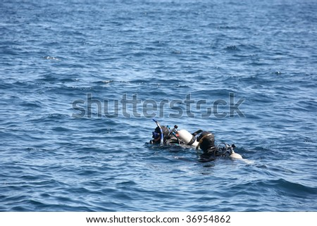 Scuba divers enjoying the deep blue ocean background