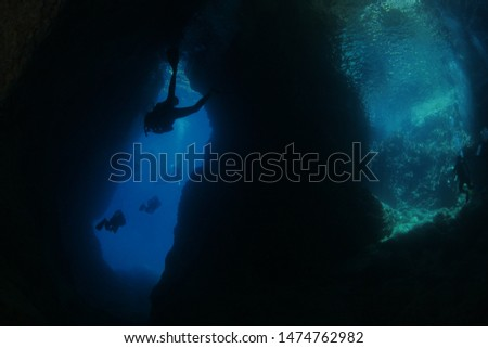 scuba divers exploring the caves underwater cave diving #1474762982