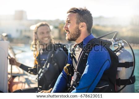 Scuba divers having fun #678623011