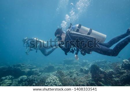 Scuba divers in Anilao Philippines #1408333541