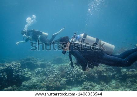 Scuba divers in Anilao Philippines #1408333544
