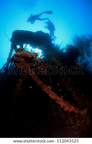 Scuba divers on a shipwreck