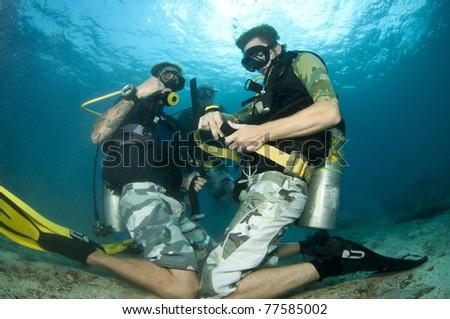 scuba divers practise skills underwater