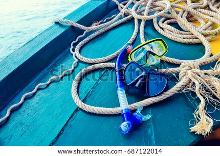 Scuba diving and snorkeling. Two snorkel on blue wood Ship deck. The deck and the ship's bow. The concept of sea voyage #687122014