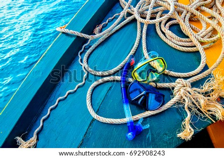 Scuba diving and snorkeling. Two snorkel on blue wood Ship deck. The deck and the ship's bow. The concept of sea voyage #692908243