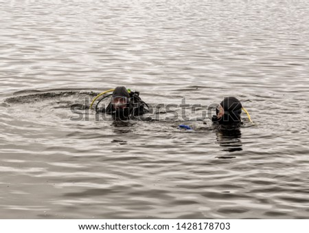 scuba diving in a mountain lake, practicing techniques for emergency rescuers. immersion in cold water #1428178703