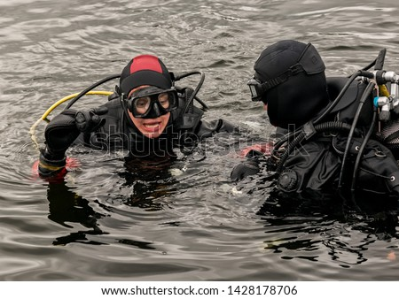 scuba diving in a mountain lake, practicing techniques for emergency rescuers. immersion in cold water #1428178706