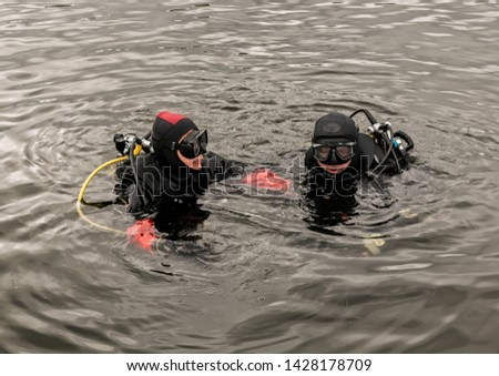 scuba diving in a mountain lake, practicing techniques for emergency rescuers. immersion in cold water #1428178709