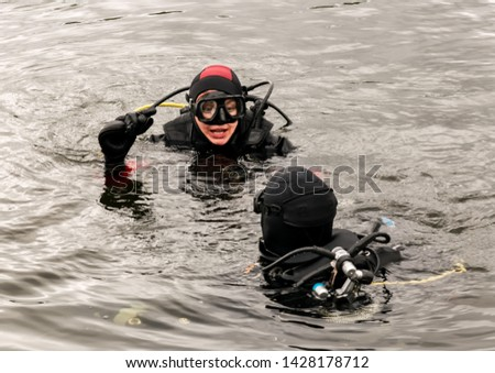 scuba diving in a mountain lake, practicing techniques for emergency rescuers. immersion in cold water #1428178712