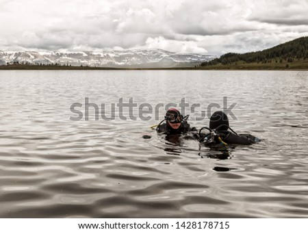 scuba diving in a mountain lake, practicing techniques for emergency rescuers. immersion in cold water #1428178715