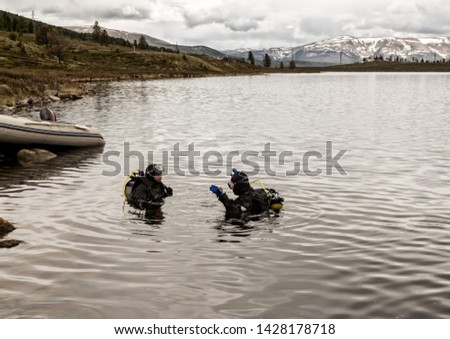 scuba diving in a mountain lake, practicing techniques for emergency rescuers. immersion in cold water #1428178718