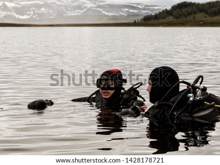 scuba diving in a mountain lake, practicing techniques for emergency rescuers. immersion in cold water #1428178721