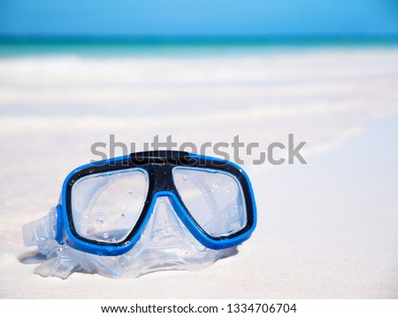 Scuba mask on sandy beach. Lifestyle concept. Nobody #1334706704