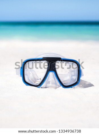 Scuba mask on sandy beach. Outdoor lifestyle concept. Nobody #1334936738