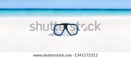Scuba mask on sandy beach. Outdoor lifestyle concept. Nobody #1341572312