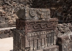 Sculpted glyphs at the pyramid temple shrine in Tepozteco archaeological site, Mexico