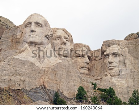 Sculpted images of Presidents George Washington, Thomas Jefferson. Theodore Roosevelt, and Abraham Lincoln at the Mt. Rushmore National Memorial, Keystone, South Dakota