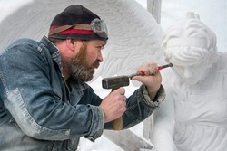 Sculptor at work .  Stone carving.