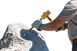 Sculptor man at work with hammer and protective gloves to carving a stone block on white background for easy selection