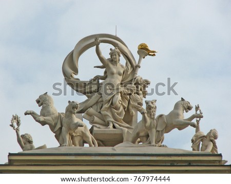 Sculptural composition - Statue of greek goddess Melpomene in a chariot drawn by four panthers of the Opera House in Odessa, Ukraine #767974444