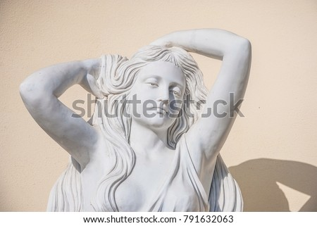 Sculptural portrait of a young thoughtful woman. (garden sculpture, not the author's work) - Shutterstock ID 791632063
