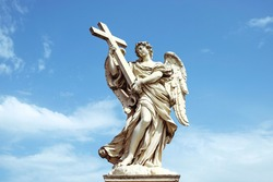 sculpture angel suggesting a cross with a roman blue sky