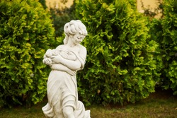 Sculpture of a girl in a public park green background