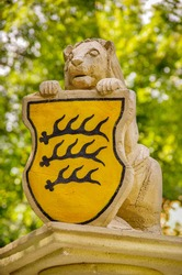 Sculpture of a lion holding the historical Wurttemberg coat of arms, Reutlingen, Baden-Wurttemberg, Germany.