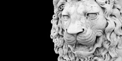 Sculpture of a medieval lion head of stone (Italy) - Image with copy space isolated on black background for easy selection