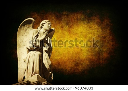 sculpture of an angel with an conceptual dark background