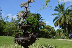 Sculpture of birds with vegetation in the background at the Ricardo Brennand Institute in Recife