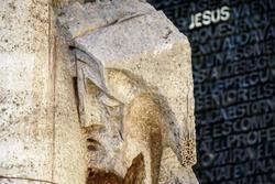Sculpture of Christ with word Jesus on door of the Gaudi's Sagrada Familia in Barcelona, Spain.