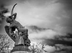 Sculpture  of  Fallen Angel in El Retiro park Madrid Spain