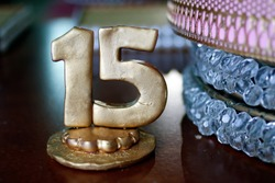 sculpture of number fifteen in golden color - party fifteen years