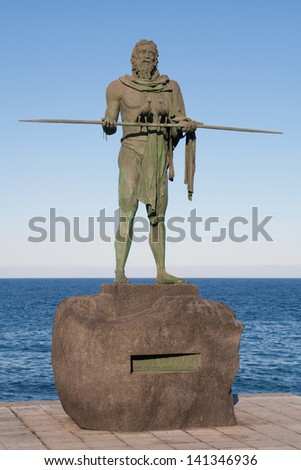 Sculpture of the guanche mencey (aboriginal king) Anaterve in the waterfront of Candelaria, Tenerife, Canary Islands, Spain.