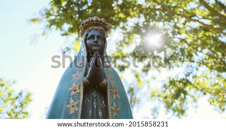 Sculpture of the image of 'Nossa Senhora Aparecida' the patroness of Brazil. On nature background on sunny day. Foto stock ©