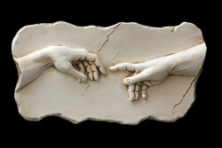 Sculpture of two hands isolated on black