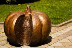 Sculpture pumpkin decorative street decoration. Decorative pumpkin Urban decorations. Autumn and Halloween.