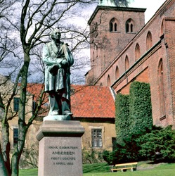 Sculpture statue of Hans Christian Andersen in front of sct Knud cathedral, Odense Denmark