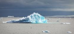 Sculptured iceberg drifting in the Gerlache Strait off the shore of the Antarctic Peninsula.