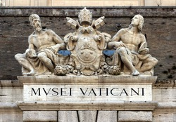 Sculptures above an entrance to the Vatican Museum in Rome, Italy