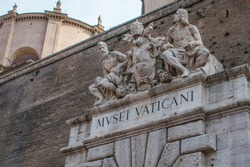 Sculptures above an entrance to the Vatican Museum in Rome, Italy (MVSEI VATICANI as shown means Vatican Museum)